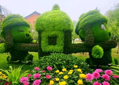 仿真绿雕制作厂家说说室外仿真植物绿雕造型的优势
